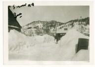 My grandma shoveling snow in the Black Hills of South Dakota, winter, 1930's